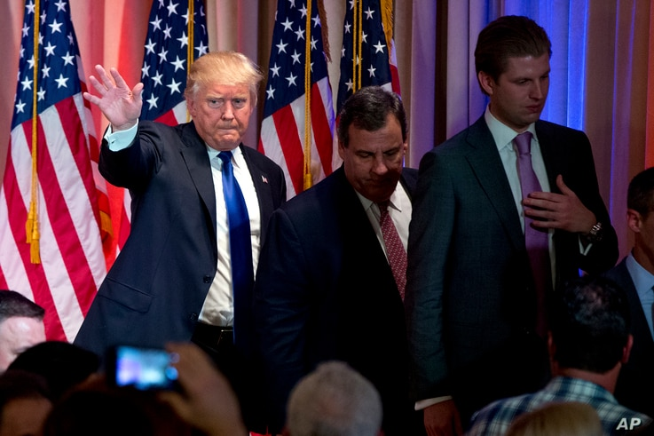 Republican presidential candidate Donald Trump, accompanied by New Jersey Gov. Chris Christie, center, and his son Eric Trump, right, depart after speaking during a news conference on Super Tuesday primary election night in the White and Gold Ballroo...
