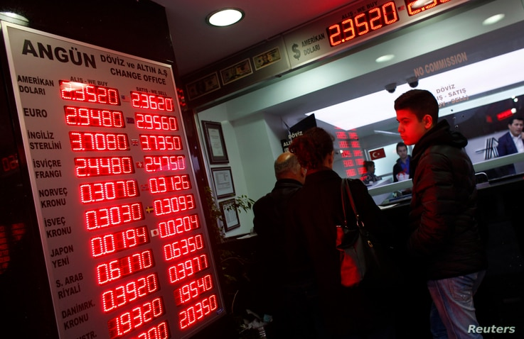 People check currency exchange rates at an currency exchange office in Istanbul, Dec. 16, 2014.