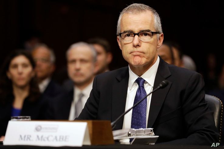 Acting FBI Director Andrew McCabe listens on Capitol Hill in Washington, May 11, 2017, while testifying before a Senate Intelligence Committee hearing on major threats facing the U.S.
