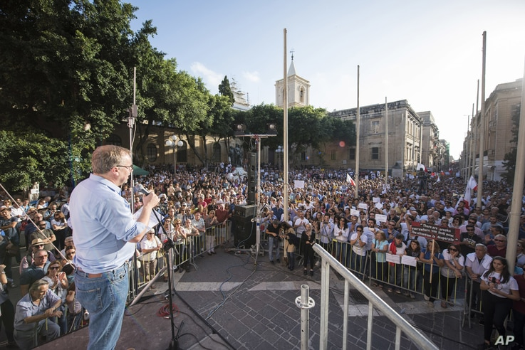Journalists Without Borders representative Christoph Deloire addresses the crowd during a rally to honor anti-corruption reporter Daphne Caruana Galizia, killed by a car bomb on Oct. 16, in the capital city of Malta, Valletta, Oct. 22, 2017.
