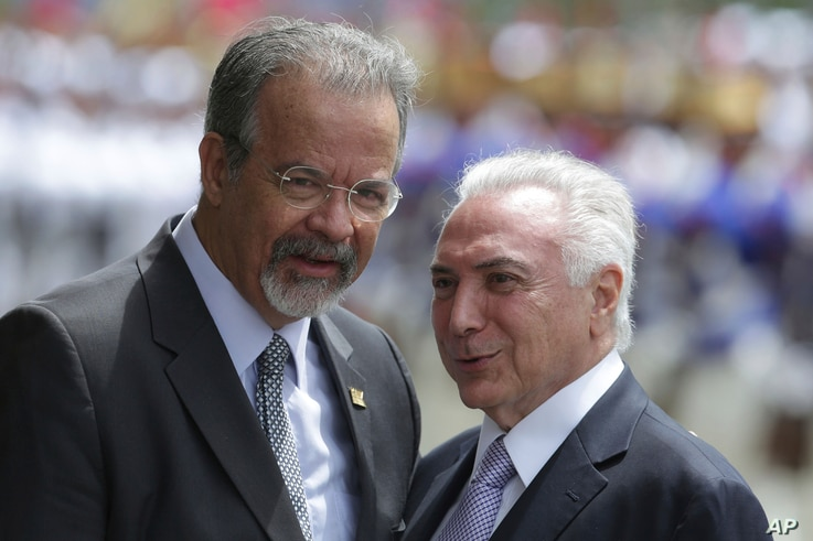 Brazil's President Michel Temer, right, talks with Defense Minister Raul Jungmann during his arrival to attend a meeting of the Defense Military Council, in Brasilia, Brazil, Feb. 22, 2018.