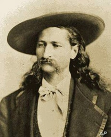 Wild Bill Hickok was holding the dead man's hand - two aces and two eights - when Jack McCall walked up and shot him dead to avenge, he said, Hickok's murder of McCall's brother.
