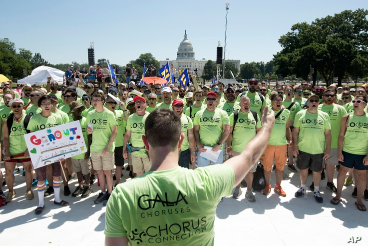 The Gay and Lesbian Association of Choruses (GALA) members from around the country sing on the National Mall with Capitol Hill in the background, during the Equality March for Unity and Pride in Washington, June 11, 2017.