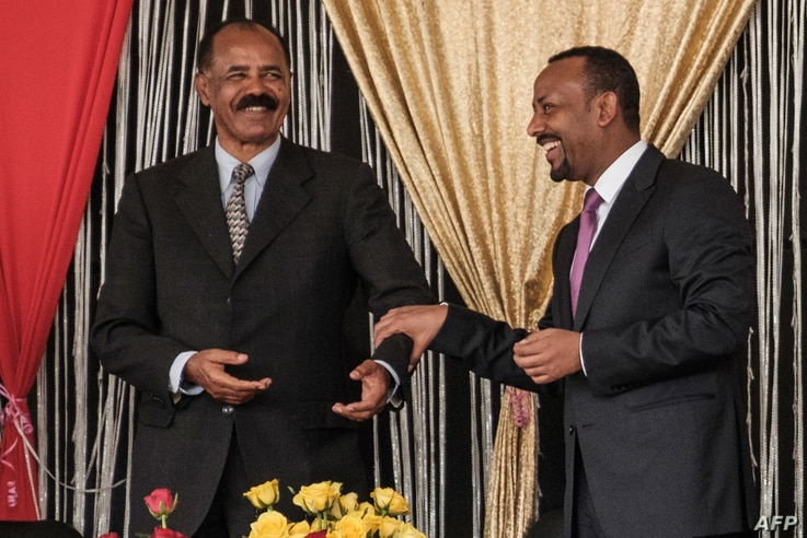 Eritrea's President Isaias Afwerki, left, and Ethiopia's Prime Minister Abiy Ahmed talk during the inauguration of the Tibebe Ghion Specialized Hospital in Bahir Dar, northern Ethiopia, Nov. 10, 2018.