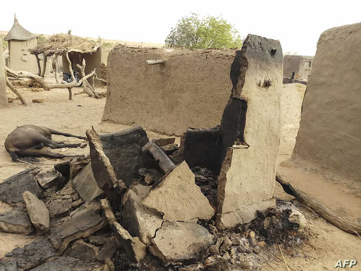 FILE - A destroyed home is seen on June 11, 2019, in the Dogon village after an attack that killed on ethnic Dogon on June 9, 2019.
