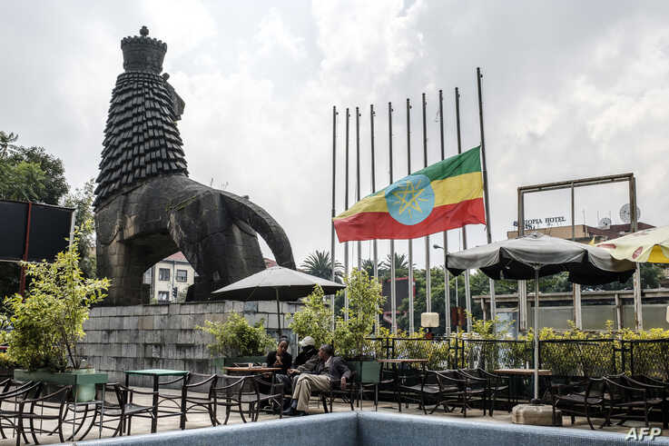 Ethiopia's national flag is lowered as the country mourns, June 20, 2019.