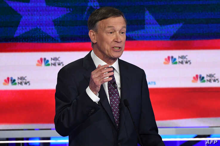 Democratic presidential hopeful former Governor of Colorado John Hickenlooper speaks during the second Democratic primary debate of the 2020 presidential campaign at the Adrienne Arsht Center for the Performing Arts in Miami, June 27, 2019.