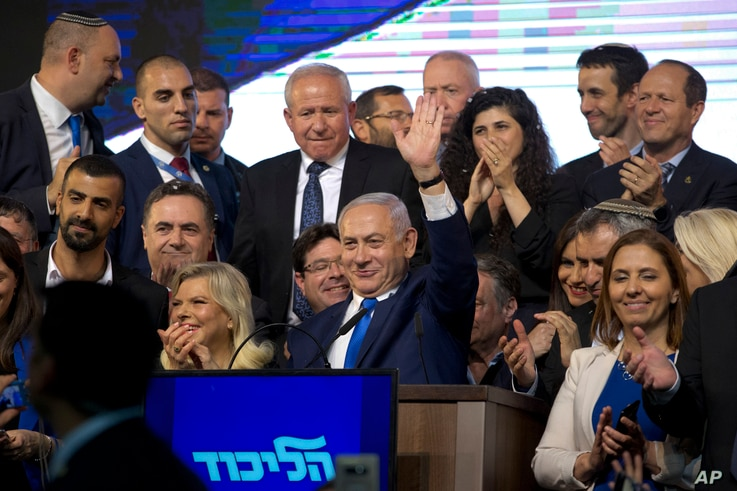 Israel's Prime Minister Benjamin Netanyahu waves to his supporters after polls for Israel's general elections closed in Tel Aviv, Israel,  April 10, 2019.