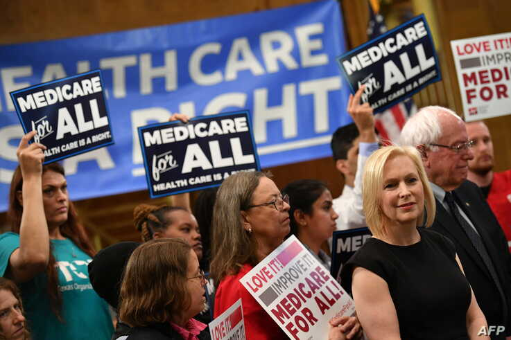 Democratic 2020 presidential hopefuls Sen. Kirsten Gillibrand (D-NY) and Bernie Sanders (I-VT) attend a Medicare For All event on Capitol Hill in Washington, April 10, 2019.