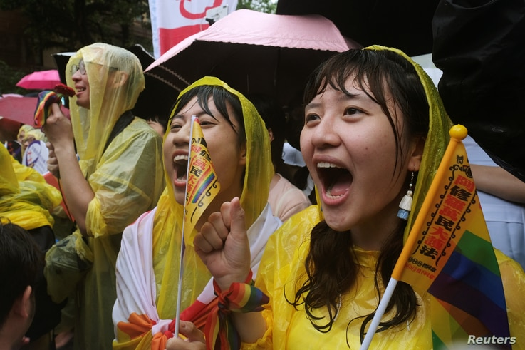 Same-sex marriage supporters shout during a parliament vote on three draft bills of a same-sex marriage law, outside the Legislative Yuan in Taipei, Taiwan, May 17, 2019.