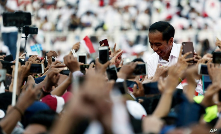 Indonesian presidential candidate Joko Widodo speaks to supporters during a campaign rally at Gelora Bung Karno Stadium in Jakarta, Indonesia, April 13, 2019.