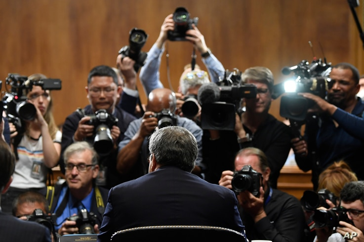 Attorney General William Barr is photographed as he sits down to testify before the Senate Judiciary Committee on Capitol Hill in Washington, May 1, 2019.