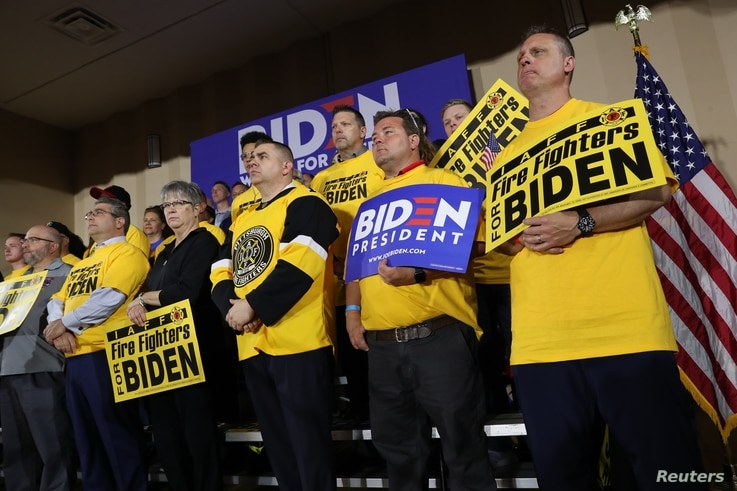 Union supporters stand behind U.S. Democratic presidential candidate and former Vice President Joe Biden as he addresses workers at the Teamsters Local 249 hall during his first public event since announcing his bid for the 2020 Democratic presidenti...