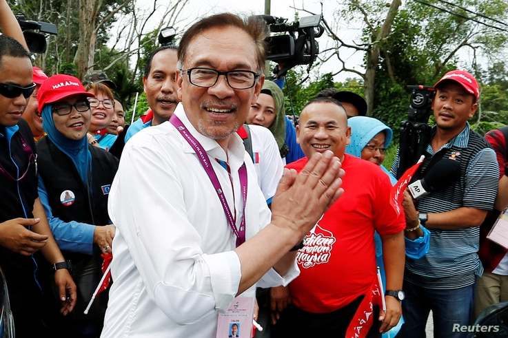FILE - Malaysia's politician Anwar Ibrahim visits a polling station during the by-election in Port Dickson, Malaysia, Oct. 13, 2018.