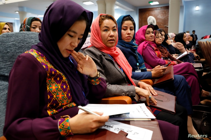 Afghan women attend a consultative grand assembly, known as Loya Jirga, in Kabul, Afghanistan, April 29, 2019.