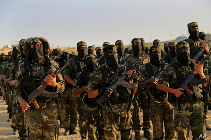 FILE - Palestinian militants of the Islamic Jihad group take part in their military exercises in Deir el-Balah, the central Gaza Strip, Dec. 11, 2014.