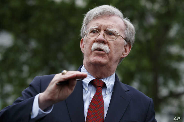 National security adviser John Bolton talks to reporters about Venezuela, outside the White House, May 1, 2019, in Washington.