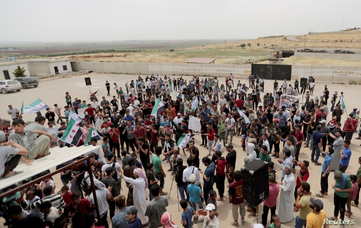 Displaced Syrians gather during a protest calling for an end to airstrikes, in Idlib province, Syria, May 31, 2019.