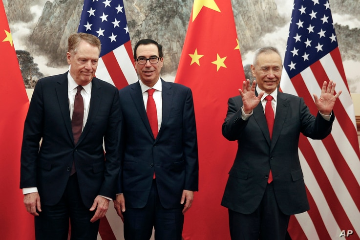 Chinese Vice Premier Liu He, right, gestures as U.S. Treasury Secretary Steven Mnuchin, center, chats with his Trade Representative Robert Lighthizer, left, before they proceed to their meeting at the Diaoyutai State Guesthouse in Beijing, May 1, 201...