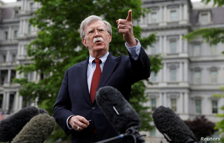 U.S. national security adviser John Bolton talks to reporters at the White House in Washington, May 1, 2019.