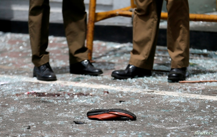 A shoe of a victim is seen in front of the St. Anthony's Shrine, Kochchikade church after an explosion in Colombo, Sri Lanka, April 21, 2019.