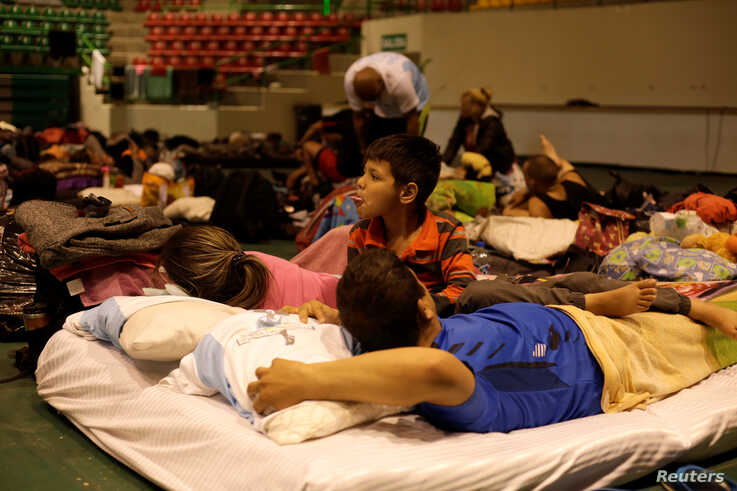 Cuban migrants, waiting for their appointment to request asylum in the U.S., rest at a gym being used as a shelter in Ciudad Juarez, Mexico, March 19, 2019.