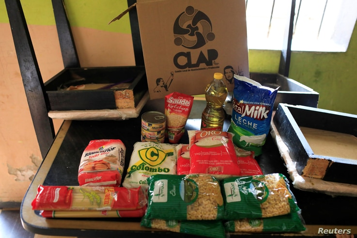 The contents of a CLAP box, a Venezuelan government handout of basic food supplies, is pictured  at Viviana Colmenares' house in the slum of Petare in Caracas, Venezuela, Feb. 23, 2018.