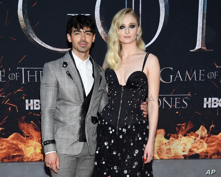 """FILE - Actress Sophie Turner, right, and boyfriend musician Joe Jonas attend HBO's """"Game of Thrones"""" final season premiere at Radio City Music Hall in New York."""