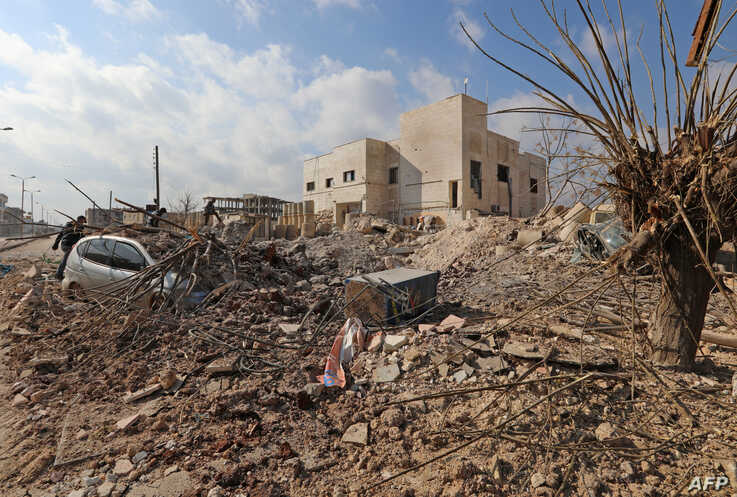 Destruction is seen around the Udai hospital following airstrikes on the town of Saraqeb in Syria's northwestern province of Idlib, Jan. 29, 2018. Syrian troops had been advancing on Idlib as part of a fierce offensive launched in late December with Russian backing.  / AFP PHOTO / OMAR HAJ KADOUR
