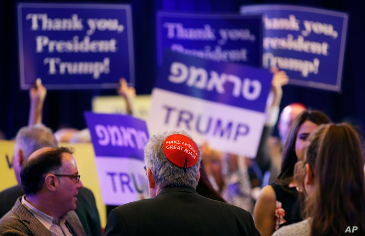 """FILE - An attendee wears a """"Make America Great Again"""" yarmulke before President Donald Trump speaks at an annual meeting of the Republican Jewish Coalition, April 6, 2019, in Las Vegas, Nevada."""