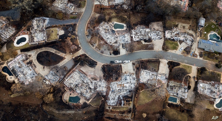 FILE - In this Dec. 3, 2018, file photo, homes leveled by the Camp Fire line Valley Ridge Drive in Paradise, Calif. Officials say the drinking water in Paradiseis contaminated with the cancer-causing chemical benzene.