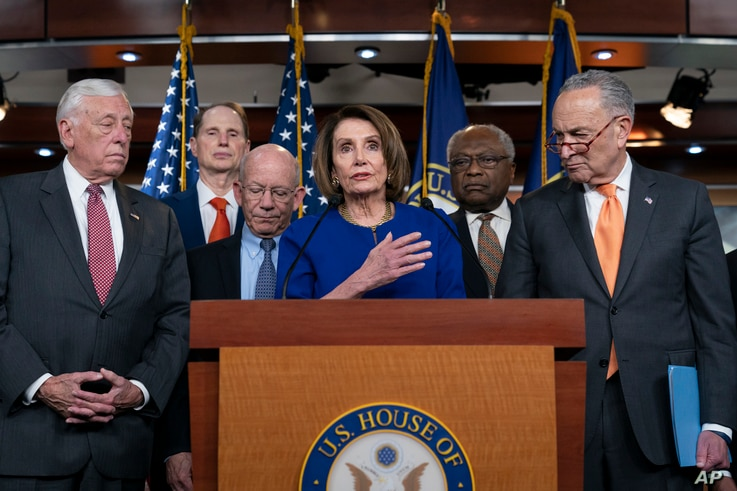 Speaker of the House Nancy Pelosi, Senate Minority Leader Chuck Schumer, and other congressional leaders react to a failed meeting with President Donald Trump, at the Capitol in Washington, May 22, 2019.