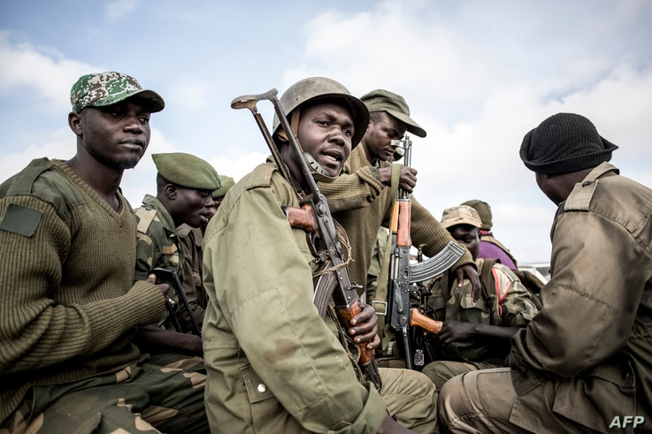Soldiers of the Armed Forces of the Democratic Republic of the Congo (FARDC) prepare to escort health workers attached to ebola response programs on May 18, 2019 in Butembo, north of Kivu.