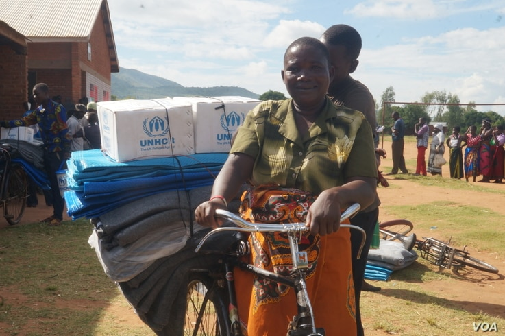 Ajaniya Kamenya is ready to return home after staying at an evacuation camp for nearly five weeks, in Phalombe district, Malawi.