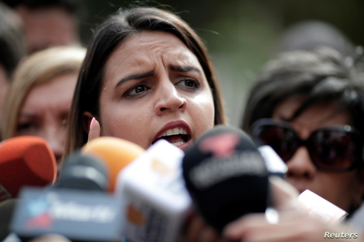 Soley Zambrano, daughter of Edgar Zambrano, National Assembly vice president, speaks during a news conference outside the 'El Helicoide', a detention center of the Bolivarian National Intelligence Service, where her father is under arrest in Caracas,...