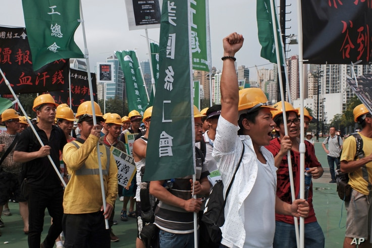 Workers march during a rally to mark the May Day in Hong Kong, May 1, 2019.