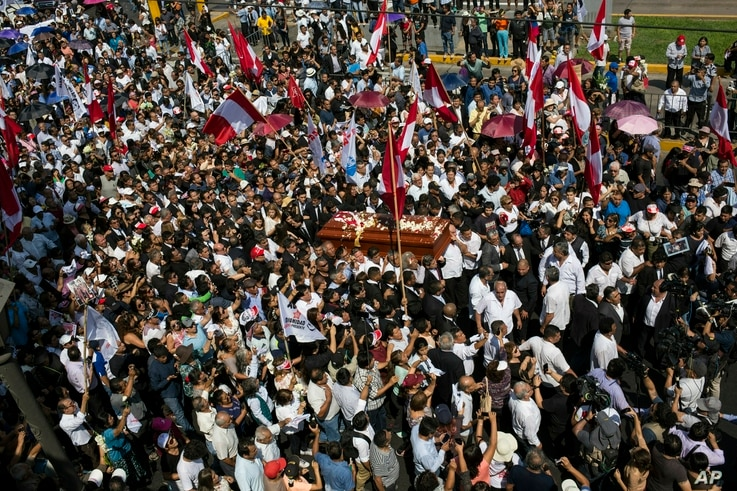 People carry the coffin of Peru's late President Alan Garcia through the street during his funeral procession in Lima, Peru, April 19, 2019.