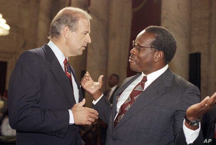 Supreme Court Justice Clarence Thomas gestures while talking with Sen. Joseph Biden, D-Del., chairman of the Senate Judiciary Committee, during a break in the committee's nomination hearing for Thomas on Capitol Hill in Washington, Sept. 13, 1991.