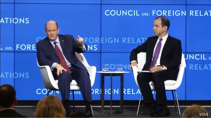 U.S. Senate Democrat Chris Coons, left, answers a VOA Persian reporter's question at the Council on Foreign Relations in Washington, May 14, 2019.