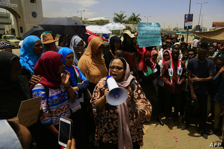 Sudanese demonstrators rally near the military headquarters in the capital Khartoum, April 16, 2019. Protesters toughened their stance Tuesday by calling  for the dissolution of the transitional military council, to be replaced immediately with a civ...