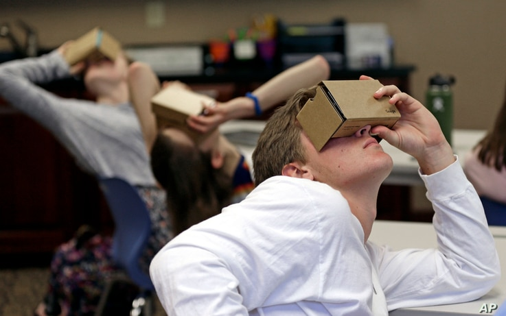 Zane Taylor and other students use virtual reality technology to learn about the D-Day invasion at Normandy during a history class at Crossroads FLEX High School in Cary, N.C., May 21, 2019.