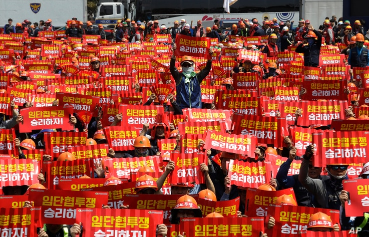 Members of the Korean Confederation of Trade Unions hold up their banners during a May Day rally in Seoul, South Korea, Wednesday, May 1, 2019. Thousands of trade union members and activists are marking May Day by marching through Asia's capitals and...