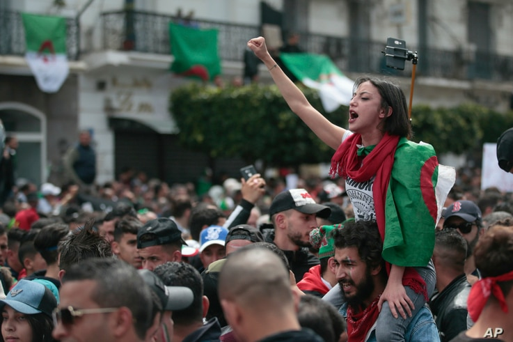 A protester chants slogans during a demonstration against the country's leadership in Algiers,  April 12, 2019.