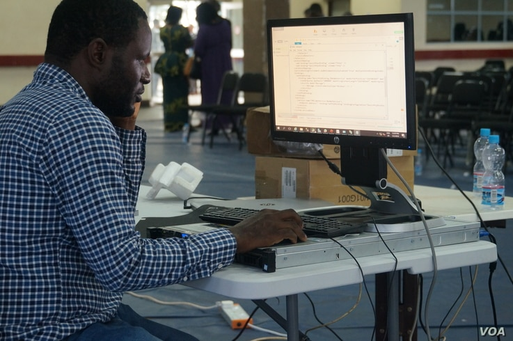 A technician analyzes poll results during a test of the Election Results Management System, at the main tallying center in Blantyre, Malawi.
