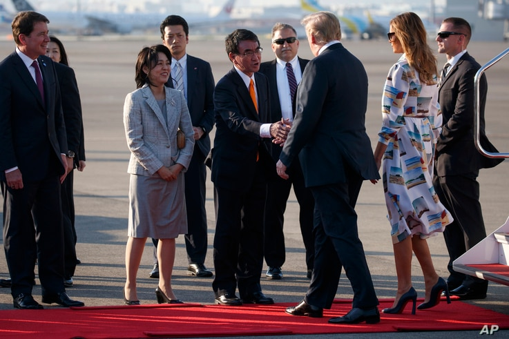 President Donald Trump and first lady Melania Trump are greeted by Japanese Minister of Foreign Affairs Taro Kono and his wife, Kaori Kono, after arriving at Haneda International Airport for a state visit, May 25, 2019, in Tokyo.