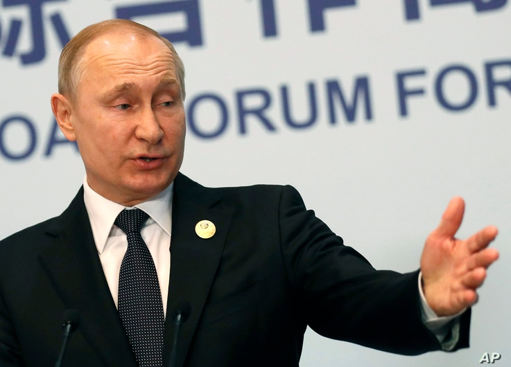 Russian President Vladimir Putin gestures while speaking to the media following the Belt and Road Forum in Beijing, China, April 27, 2019.