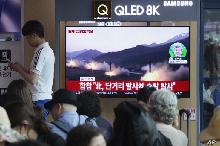 FILE - People watch a TV showing file footage of North Korea's missile launch during a news program at the Seoul Railway Station in Seoul, South Korea, May 4, 2019.  North Korea on Saturday fired several unidentified short-range projectiles into the ...