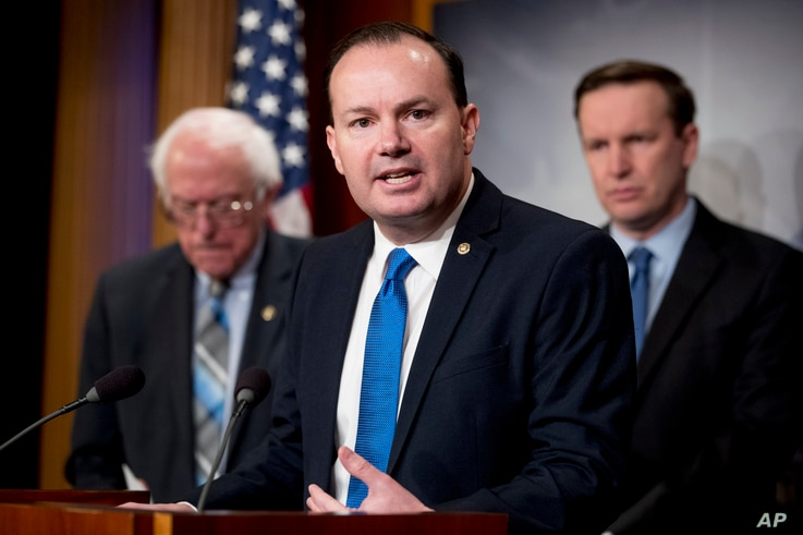 Sen. Mike Lee, R-Utah, accompanied by Sen. Bernie Sanders, I-Vt., left, and Sen. Chris Murphy, D-Conn., speaks at a news conference on Capitol Hill in Washington, Jan. 30, 2019, on a reintroduction of a resolution to end U.S. support for the Saudi-le...