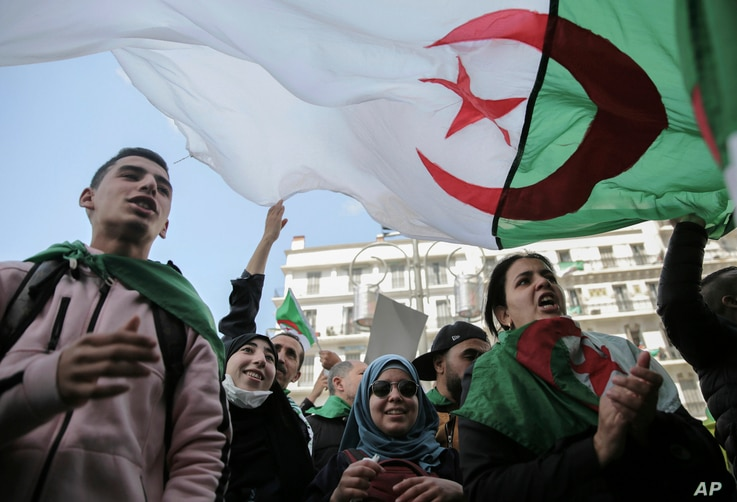 Young people chant slogans during an anti-government demonstration in Algiers, Algeria, April 10, 2019.
