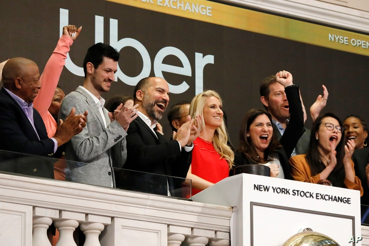 Uber CEO Dara Khosrowshahi, third from left, is seen at the opening bell ceremony at the New York Stock Exchange, as the ride-hail giant makes its initial public offering, May 10, 2019.